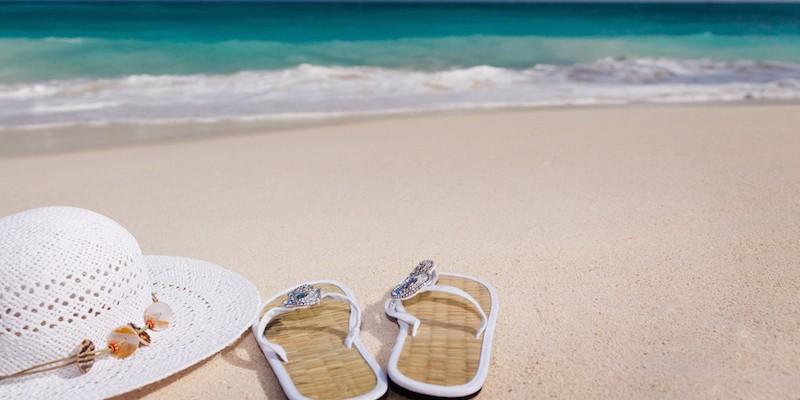 Flip flops på stranden